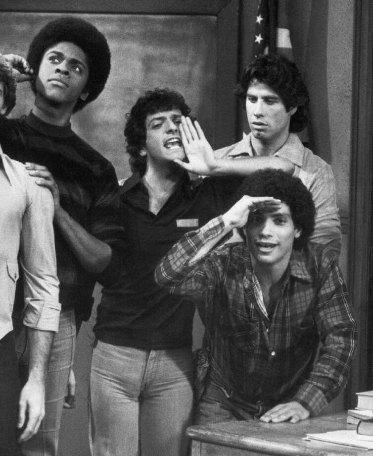 """This 1978 file photo originally from ABC shows cast members, from left, Lawrence Hilton-Jacobs as Freddy Washington, Ron Palillo as Arnold Horshack, Robert Hegyes as Juan Epstein, foreground, John Travolta, rear, as Vinnie Barbarino from the television sitcom """"Welcome Back, Kotter."""" Palillo died Tuesday in Palm Beach Gardens, Fla., of an apparent heart attack. He was 63. Hegyes died earlier this year. Photo: Uncredited"""