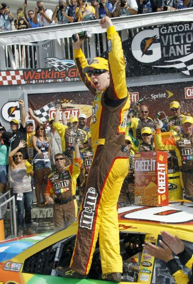 Kyle Busch celebrates in Victory Lane after winning a NASCAR Sprint Cup Series auto race in Watkins Glen, N.Y. Photo: Russ Hamilton Sr.