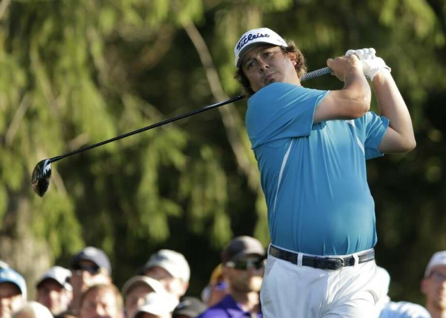 Jason Dufner hits his tee shot on the 18th hole during the final round of the PGA Championship. Dufner won the tournament by three shots. Photo: Charlie Riedel