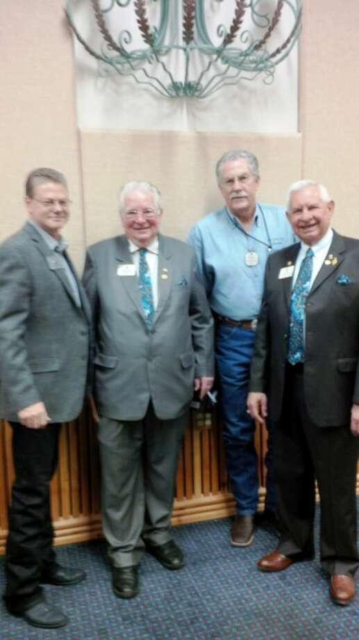 Pictured, left to right, Conroe Noon Lions Club President Wes Carr, International President Barry J. Palmer, Past Council Chair Pat H. Brennan and Joe Al Picone, Past International Director of Brenham, Texas.