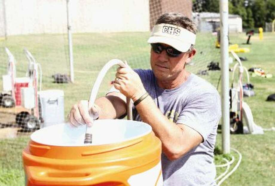 First-year Conroe coach Robert Walker guided his team through practice on Monday.` Photo: Staff Photo By Jason Fochtman / Conroe Courier