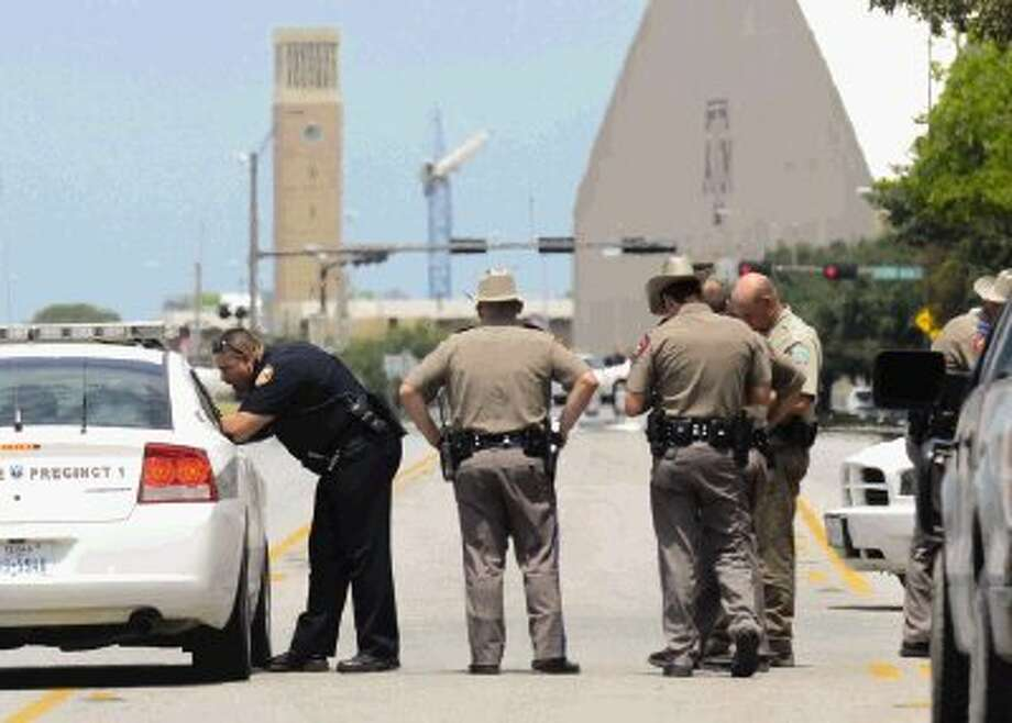 Texas State troopers and Brazos Valley lawmen work the scene of a shootout Monday in College Station. Three were killed, including Brazos County Constable Brian Bachmann was, a 43-year-old man and the gunman. Three other officers and a 55-year-old woman were wounded. Photo: Dave McDermand / College Station Eagle