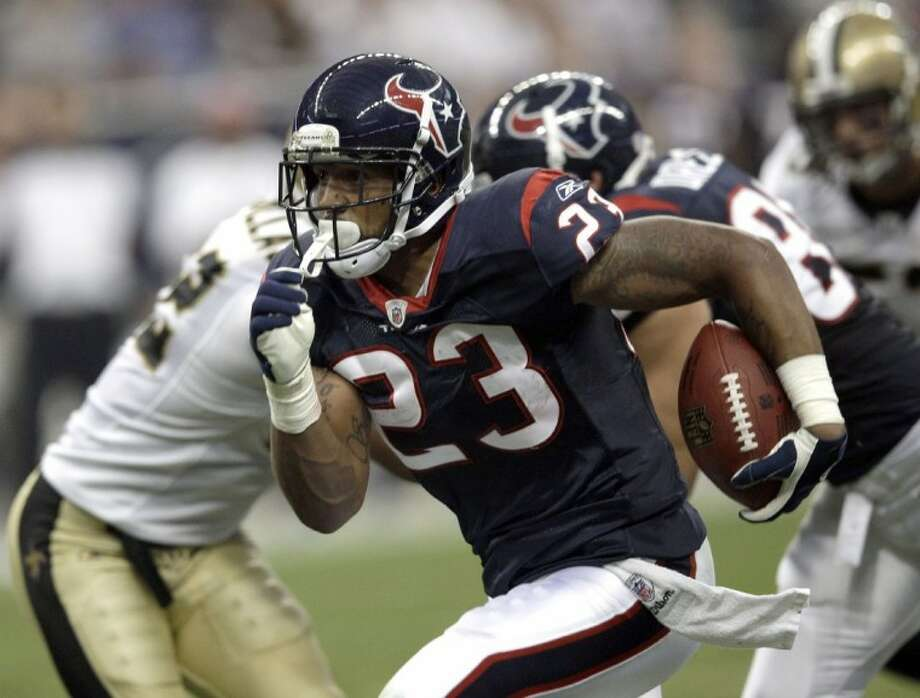 Houston Texans running back Arian Foster rushes for a touchdown in the first quarter against the New Orleans Saints on Saturday in Houston.