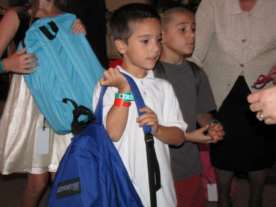 The Abundant Life Church in Willis handed out more than 300 backpacks filled with school supplies on Sunday out of the 450 it purchased. It plans to distribute the rest throughout the week and at it's service at 10 a.m. Aug. 26.