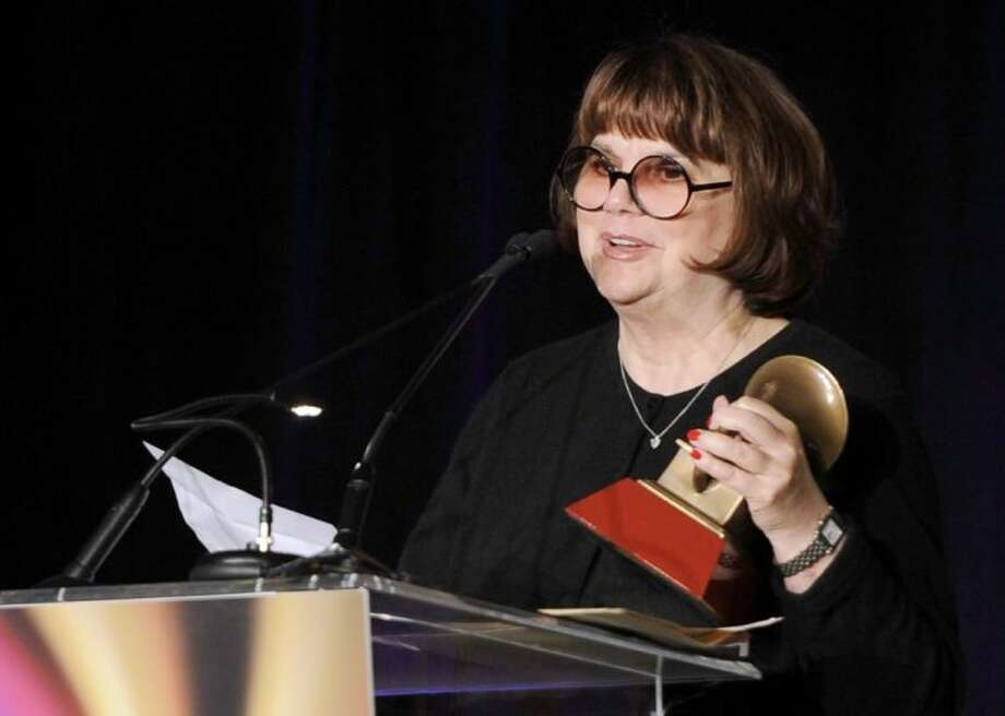 """In a Nov. 9, 2011, file photo Linda Ronstadt accepts the Life Time Achievement award at the Latin Recording Academy Lifetime Achievement Award and Trustees Award ceremony in Las Vegas. In an AARP Magazine article posted online Friday, Ronstadt says that she was diagnosed with Parkinson's disease and """"can't sing a note."""""""