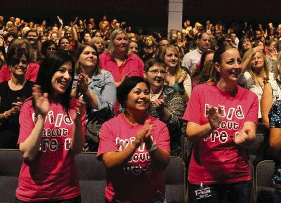"Michelle Venza, Anna Champion and Alison Witt cheer as students sing ""What a Wonderful World"" during Conroe ISD's ""Celebrate Our Schools"" event at Woodlands Church in The Woodlands Thursday. Go to HCNPics.com to view more photos from the event. Photo: Staff Photo By Jason Fochtman"