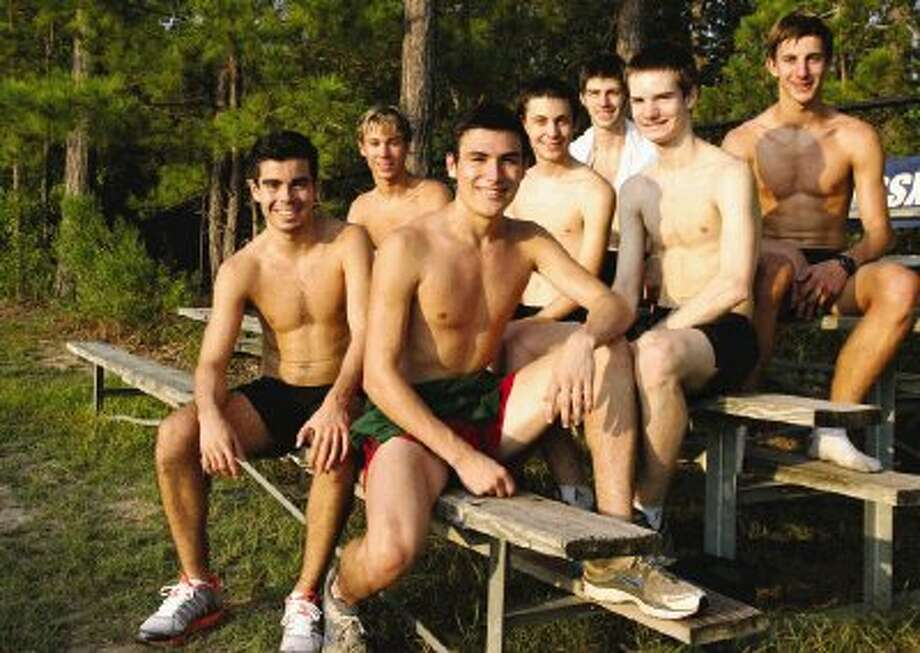 The Woodlands High School varsity cross country runners, from left, Chris Vargas, Eric Vibrock, Brigham Hedges, Jake Hendrick, Craig Irvin, Kevin Hill and Conner Moncrief. Photo: Eric S. Swist