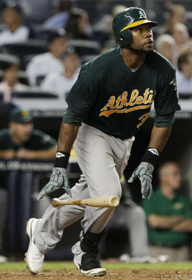 The Oakland Athletics' Brandon Allen hits the second of two home runs in the eighth inning against the New York Yankees on Tuesday at Yankee Stadium in New York.
