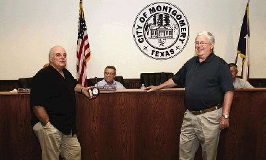 Montgomery Mayor John Fox, right, thanks Precinct 1 Commissioner Mike Meador for his assistance with local projects benefiting the community at Tuesday's Montgomery City Council meeting.