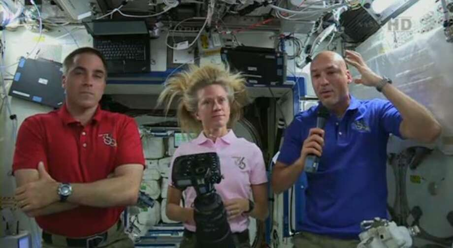 In this image from video made available by NASA, Italian astronaut Luca Parmitano, right, describes the water in his helmet on the Tuesday, July 16, 2013 spacewalk with U.S. astronaut Chris Cassidy, right, during a news conference with U.S. astronaut Karen Nyberg on the International Space Station on Thursday, July 13, 2013. Parmitano, Italy's first and only spacewalker, could not hear or speak by the time he re-entered the space station on Tuesday, 1½ hours after stepping out. He also said he had difficulty seeing because of the big globs of water in his helmet and elsewhere in his suit. Photo: Uncredited