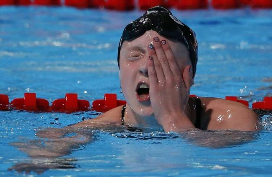 Katie Ledecky of the United States reacts after winning the gold medal in the women's 800-meter freestyle final Saturday at the FINA World Championships in Barcelona, Spain. Ledecky won in a world-record time of 8 minutes, 13.86 seconds. Photo: Daniel Ochoa De Olza