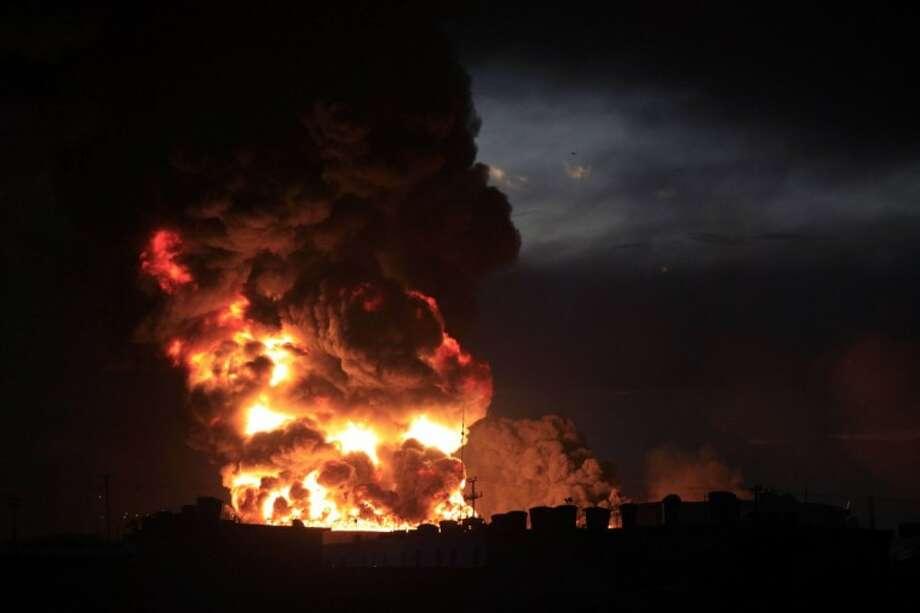 A large fire rises over the Amuay refinery near Punto Fijo, Venezuela. Photo: Ariana Cubillos