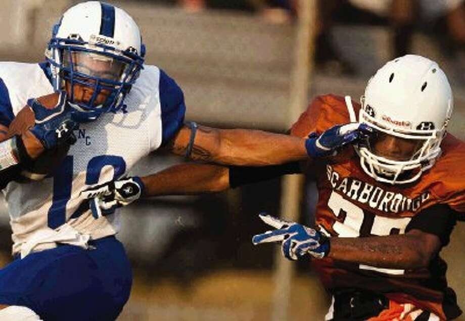 New Caney's Cory Labbe pushes past a Scarborough defender for a touchdown during Saturday's non-district game at Dyer Stadium in Houston. View more photos from this game and others online at: www.yourconroenews.com/photos