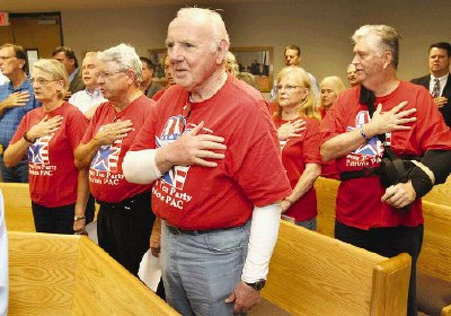 Numerous Texas Tea Party Patriots PAC members, many in their traditional red T-shirts, attended Montgomery County Commissioners Court Monday.