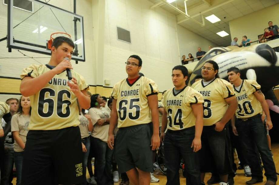 """Conroe High School varsity football sophomore defensive lineman Quentin Frerichs (66) introduces himself during the 2012 """"Meet the Tigers"""" event in the CHS gym on Monday. Photo by Jerry Baker"""
