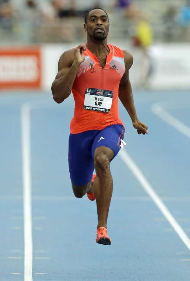Tyson Gay runs to the finish line to win the senior men's 200-meter dash final at the U.S. Championships on June 23 in Des Moines, Iowa. Gay failed more than one drug test this year, recording one of his positives at the U.S. Championships, where he won the 100 and 200 meters, The Associated Press learned on Friday. Photo: Charlie Neibergall