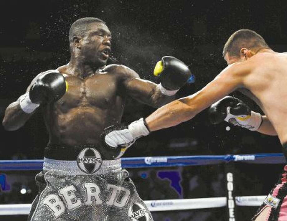 Jesus Soto Karass of Mexico, right, stopped Andre Berto in the 12th round of their welterweight fight on Saturday night in San Antonio. Photo: Darren Abate / FR115 AP
