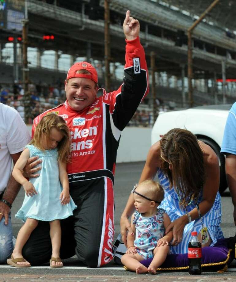Sprint Cup Series driver Ryan Newman celebrates with his wife, Krissie, and daughters, Brooklyn, left, and Ashlyn, after winning the Brickyard 400 in Indianapolis. Photo: Doug McSchooler
