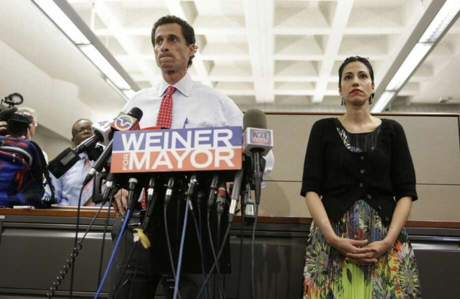 New York mayoral candidate Anthony Weiner speaks during a news conference alongside his wife Huma Abedin at the Gay Men's Health Crisis headquarters, Tuesday in New York. The former congressman says he's not dropping out of the New York City mayoral race in light of newly revealed explicit online correspondence with a young woman.