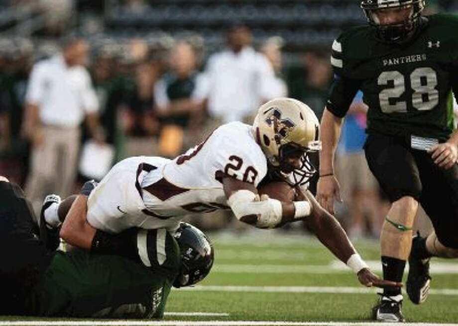 Magnolia West's Desmond Richards reaches out for a touchdown during the first-quarter of Thursday night's non-district game against Kingwood Park at Turner Stadium in Humble.