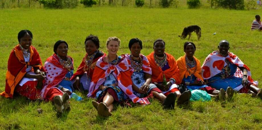 Elizabeth Kubacki (middle), a 2010 graduate of The Woodlands High School, sits with the Maasai women of the village she lived in for nine months in Kenya.