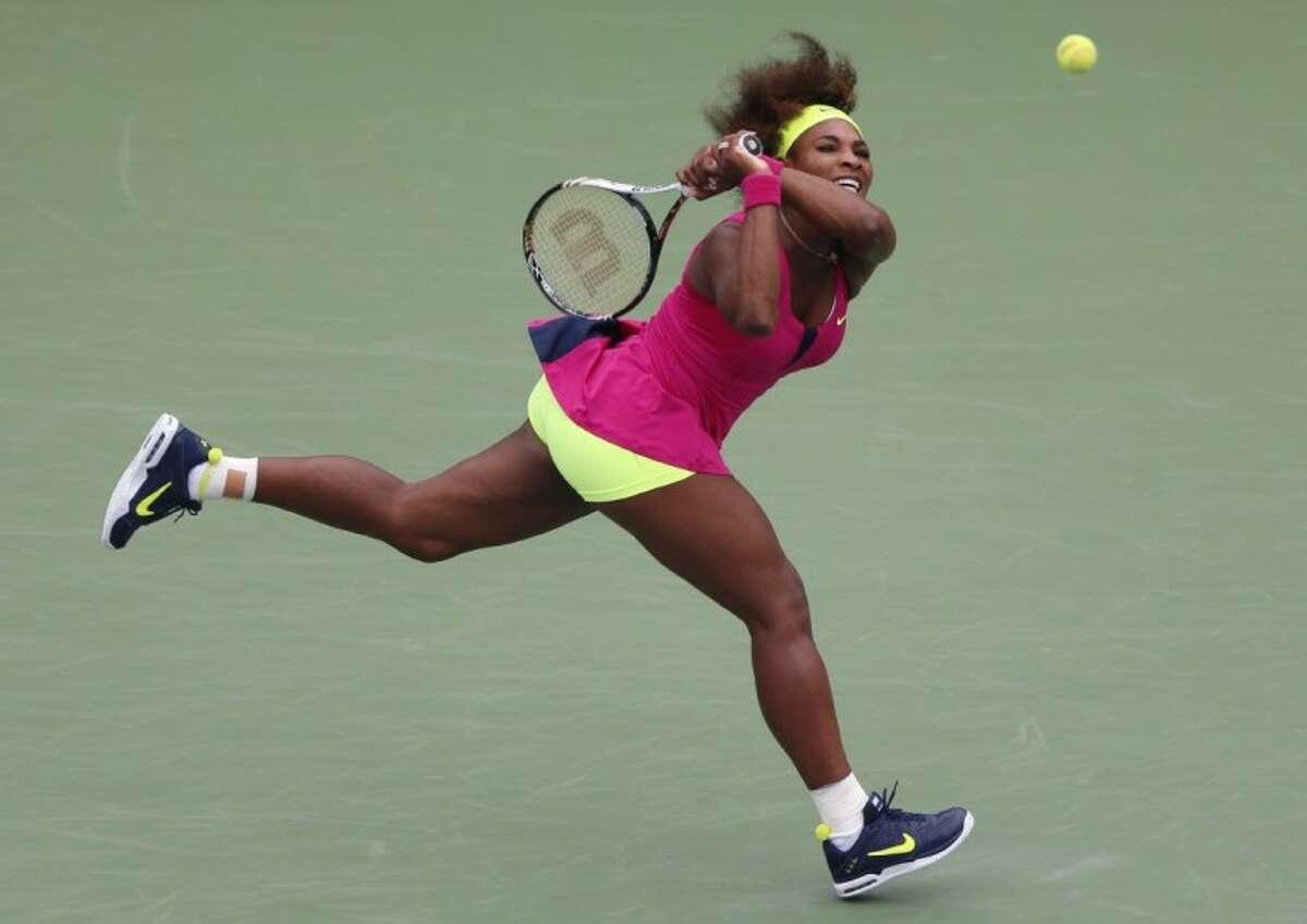 Serena Williams returns a shot to Czech Republic's Andrea Hlavackova in the U.S. Open. Williams won 6-0, 6-0.