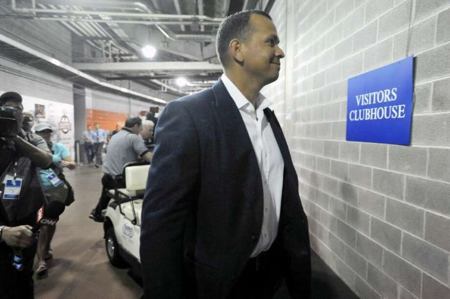 The New York Yankees' Alex Rodriguez arrives at U.S. Cellular Field before an MLB baseball game between the Chicago White Sox and New York Yankees on Monday. Rodriguez was suspended through the 2014 season on Monday, but can play after filing an appeal. Photo: PAUL BEATY