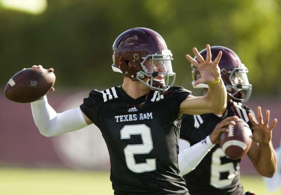 Texas A&M quarterback Johnny Manziel has become a lightning rod for his team after winning the Heisman Trophy last season. Photo: Patric Schneider