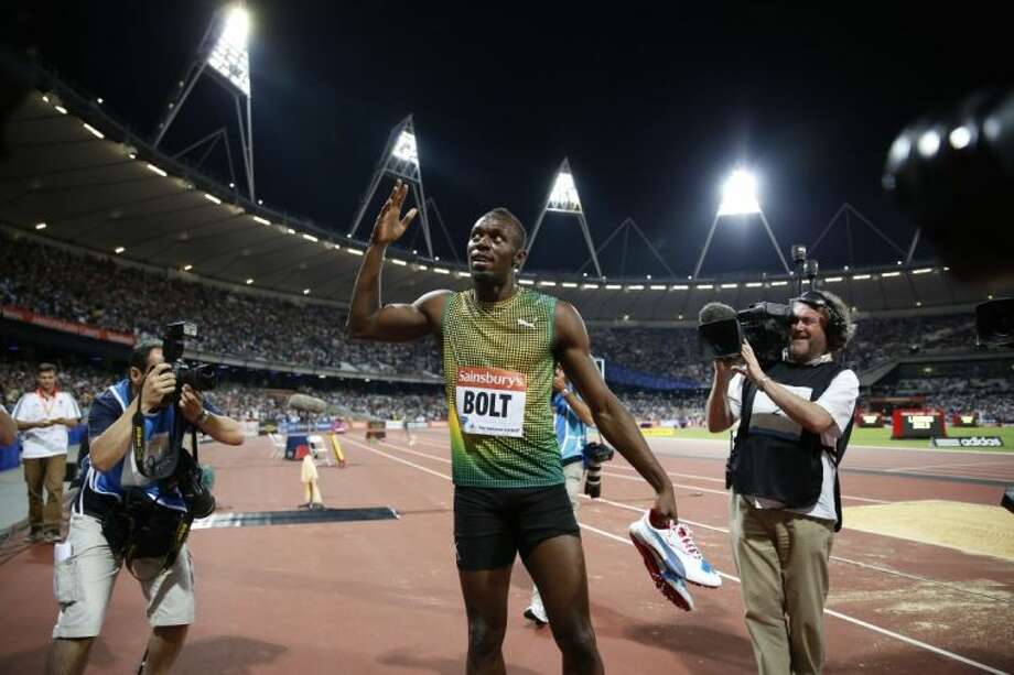 Jamaica's Usain Bolt gestures to the crowd during a victory lap after winning the men's 100-meter race during a Diamond League meet last month in London. Photo: Matt Dunham