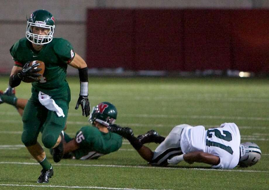 The Woodlands High School's Tyler Patrick sprints downfield during Friday night's game against Hightower at Woodforest Bank Stadium in Shenandoah.