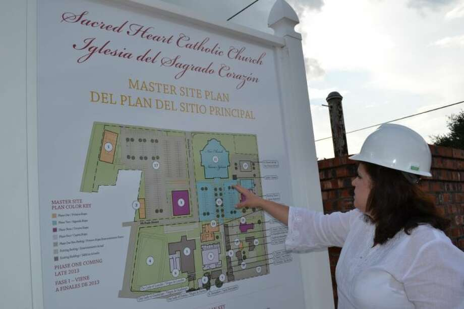 Sacred Heart Church Business Manager Eileen Borski points to the Master Site Plan of the current church and campus expansion during its three-year, $4.5 million capital campaign.