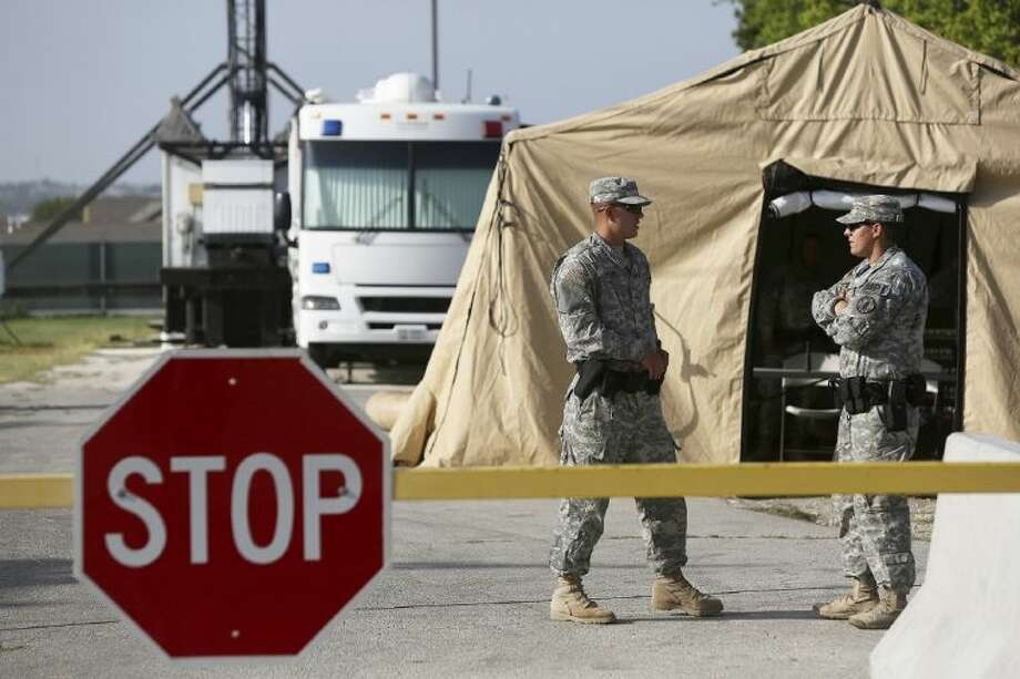 Soldiers guard a security checkpoint outside the Lawrence H. Williams Judicial Center on the second day of the trial for Maj. Nidal Hasan at Fort Hood on Wednesday.