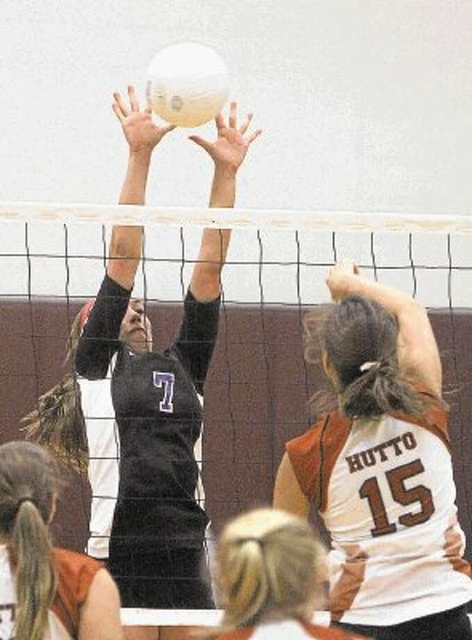 Willis' Abby Irvine, pictured blocking a shot in the Magnolia Tournament earlier this season, had 16 kills Tuesday as the Ladykats defeated Brenham in four sets. Photo: Staff Photo By Jason Fochtman / @WireImgId=2639700