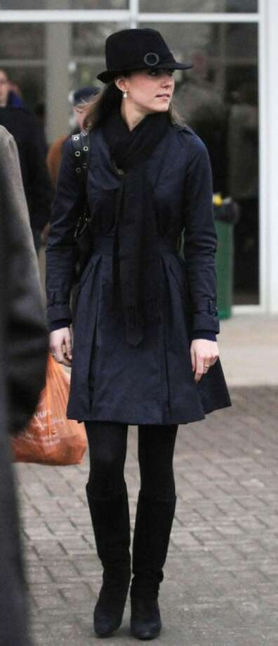 In this March 14, 2008, file photo, Kate Middleton, the girlfriend of Britain's Prince William, leaves Cheltenham Racecourse in Cheltenham, England.