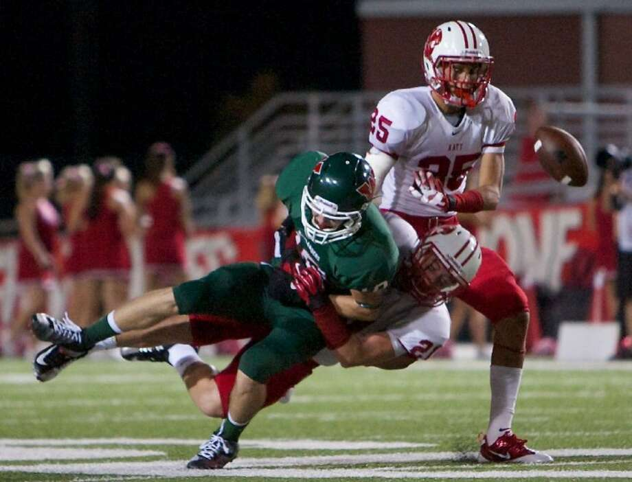 The Woodlands' Houston Brown is tackled by Katy's Quinn Atwood during Saturday's game at Woodforest Bank Stadium in Shenandoah. To purchase or view this photo and others like it visit: www.yourconroenews.com/photos