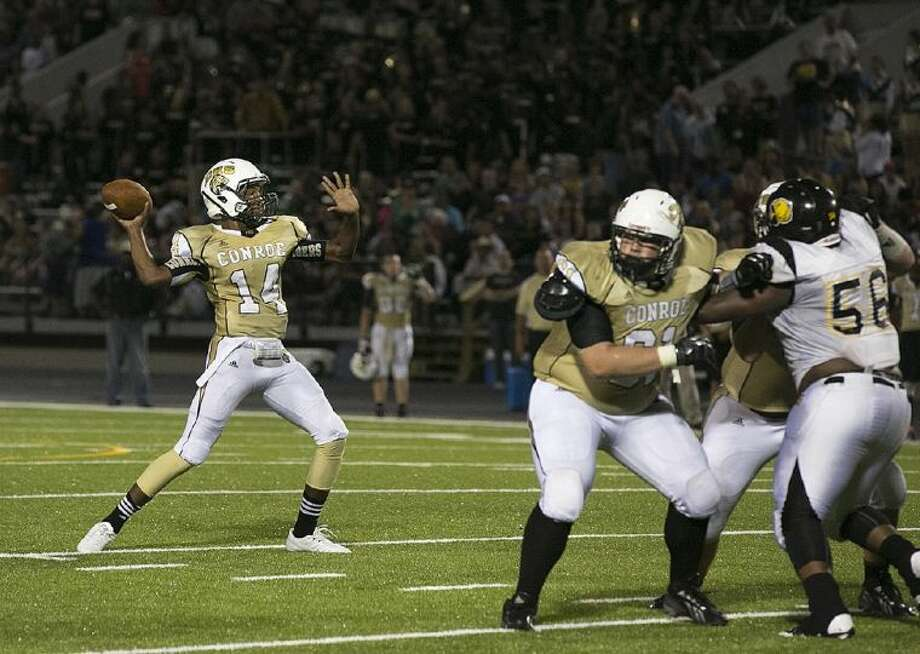 Conroe Tiger quarterback Stedman Bell prepares to unleash a touchdown strike to Zach Jones in second-quarter action against Aldine Hastings Friday night.