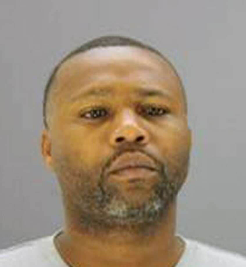 Van Dralan Dixson is shown in this photo provided by the Dallas Police Department. Authorities have located a car belonging to Dixson, a crime watch volunteer charged in one of nine sexual assaults in South Dallas. Photo: Uncredited / AP2013