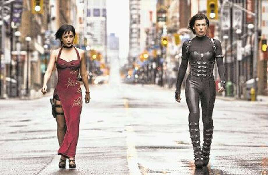"Milla Jovovich, right, stars as Alice in ""Resident Evil: Retribution,"" the fifth movie in the zombie series created by her director husband Paul W.S. Anderson."