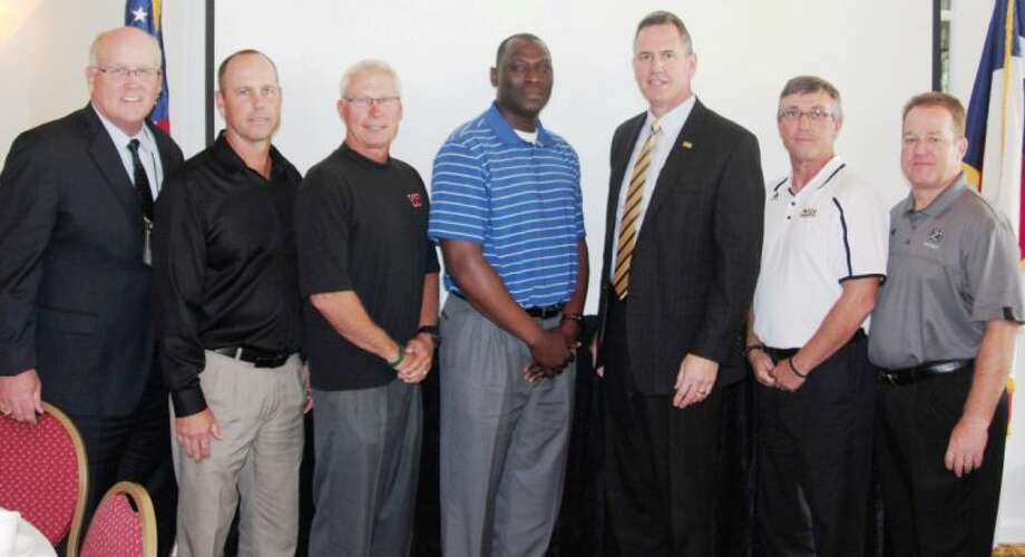 "Conroe ISD head football coaches spoke at The Woodlands Rotary Club on Sept. 5 at The Woodlands Conference Center and Resort. Brent Verzwyvelt (Caney Creek), Robert Walker (Conroe), Dereck Rush (Oak Ridge), Mark Schmid (The Woodlands) and Richard Carson (College Park) spoke on behalf of their players and coaches. All five coaches displayed their excitement for the season, but moreso, pride in their players. ""Many like to point out the negatives in schools, but everyday positive things take place in schools; and you can see some of these positives at football games — from the band, drill team, cheerleaders, football players, and all involved,"" Carson said. The coaches speak yearly at Lions Clubs and Rotary Clubs at the beginning of the season, and this was their final speaking engagement."