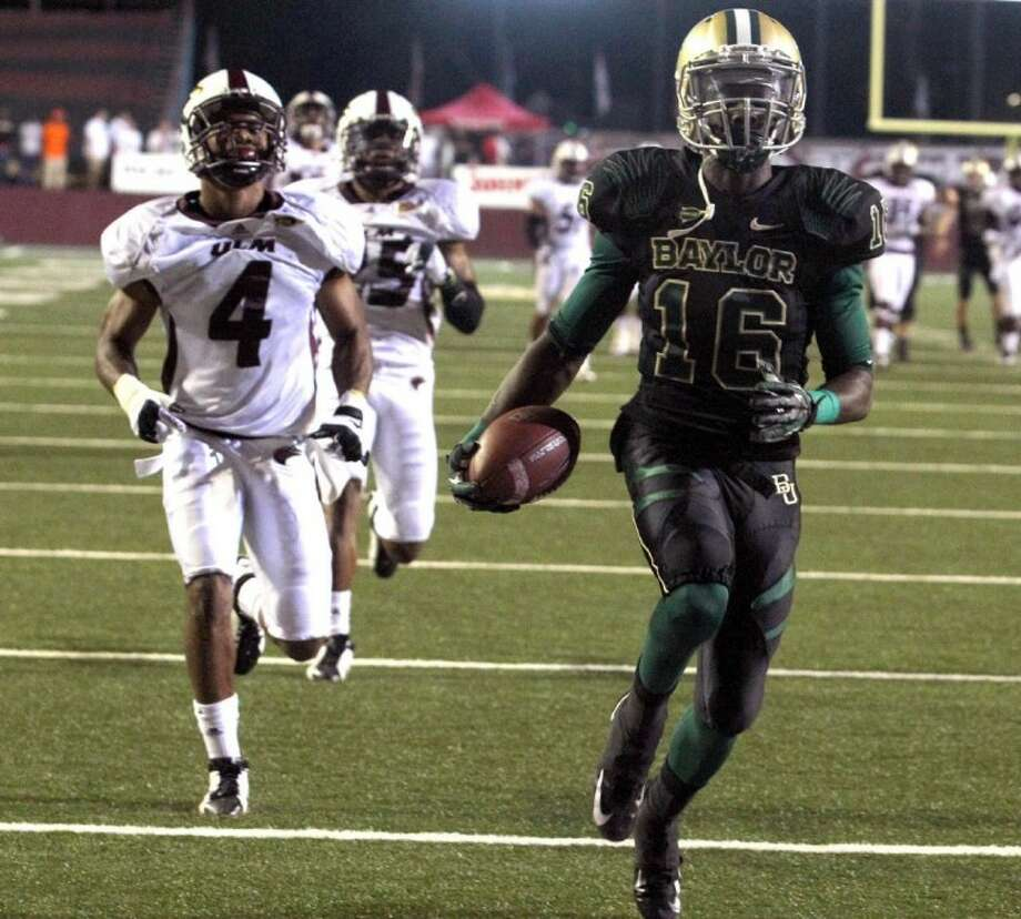 Baylor receiver Tevin Reese scores ahead of Louisiana-Monroe defender Rob'Donovan Lewis in the first half Friday in Monroe, La. Photo: Duane A. Laverty