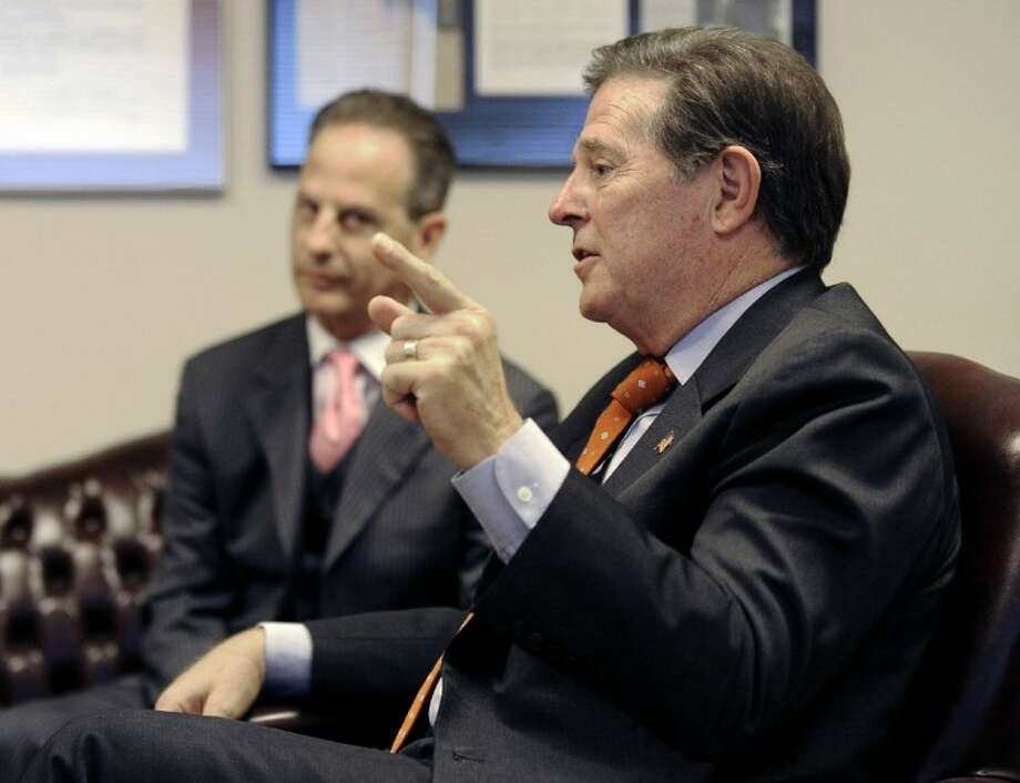 In this Wednesday photo, former House Majority Leader Tom DeLay speaks about his upcoming appeal on a money laundering conviction, as his attorney Brian Wice listens, in Houston. Photo: Pat Sullivan