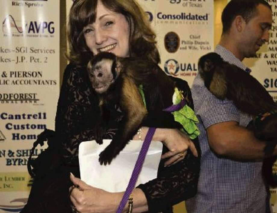 Lion Judy Fetters found a new friend last week at the Conroe Noon Lions Club - Annual 'Legend of the Lion' - Dinner/Dance & Auction; using a safari theme, 2-cute Capuchin monkeys welcomed the guests into the event.
