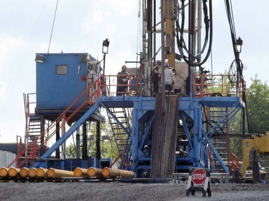 A crew works on a gas drilling rig at a well site for shale based natural gas in Zelienople, Pa. It sounds like a free-market success story: a new gas drilling boom driven by hydraulic fracturing, or fracking, which delivers a vast new source of cheap energy without the government subsidies that solar and wind power demand. But men who helped pioneer fracking recall a different story. From the shale fields of Texas and Wyoming to the Marcellus in the northeast, the U.S. Department of Energy contributed more than 100 million in direct federal research to help develop fracking, and Congress added 10 billion in tax breaks. Now, some of the biggest supporters of shale gas say the government should continue to back renewable energy research - for decades, if need be - to deliver future breakthroughs in that field. Photo: Keith Srakocic