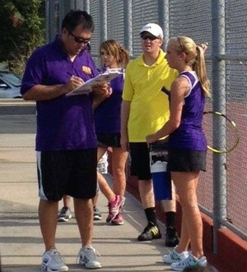 Montgomery sophomore Molly Hinkle talks with coaches Chris Cheng and Josh Boyd following her singles match against Caney Creek on Tuesday. The Bears won 10-0 to improve to 2-0 in District 18-4A play.