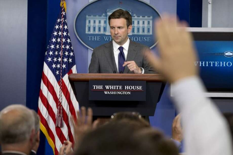 White House deputy press secretary Josh Earnest answers reporters' questions in the briefing room of the White House Thursday, where he talked about Syria and the use of chemical weapons as the administration debates what action to take.