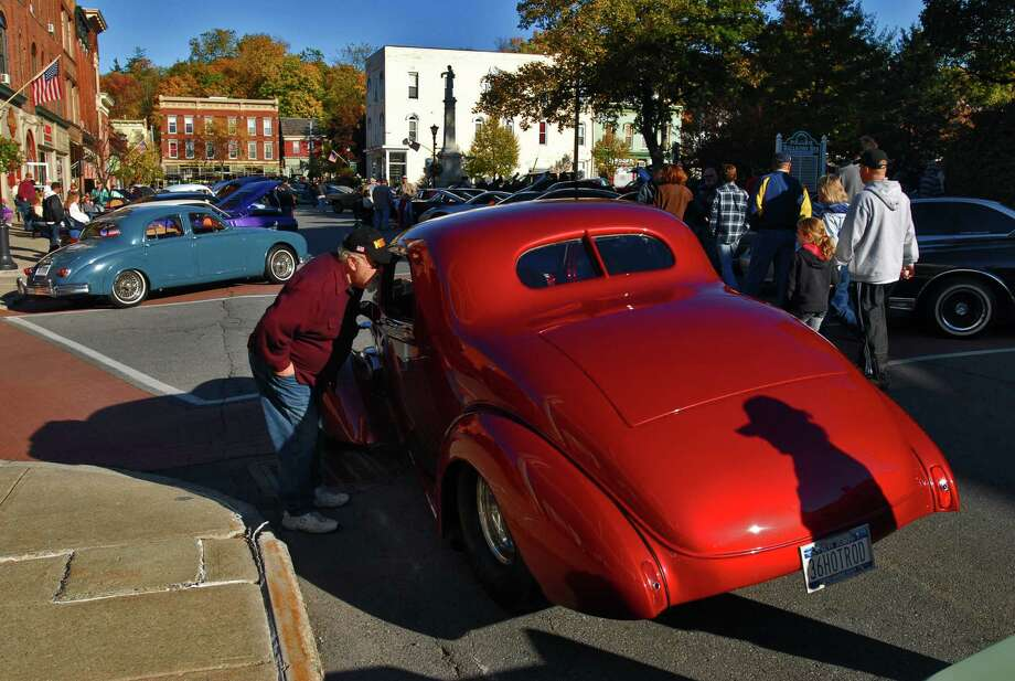 A man looks over a 1936 Chevy Coupe owned by Ralph Green,  during The Way We Were car show in Ballston Spa, NY on Sunday October 11, 2009. (Philip Kamrass / Times Union) Photo: PHILIP KAMRASS / 00005862A