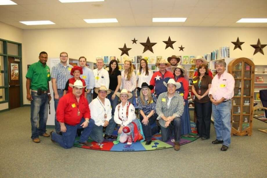 Houston Livestock Show and Rodeo committee volunteers educated and entertained students at WISD's Meador Elementary Friday. Meador scholars learned about Texas music and history, ranching, cattle drives, livestock, Texas towns, rodeo clowns and dancing.