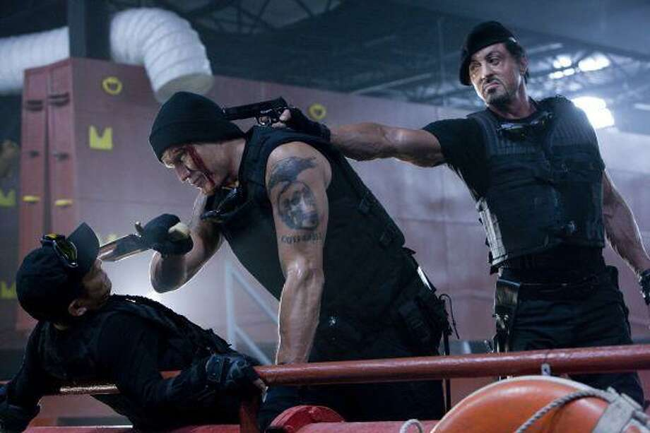 "In this film publicity image released by Lionsgate Entertainment, from left, Jet Li, Dolph Lundgren and Sylvester Stallone are shown in a scene from ""The Expendables."" / Lionsgate"