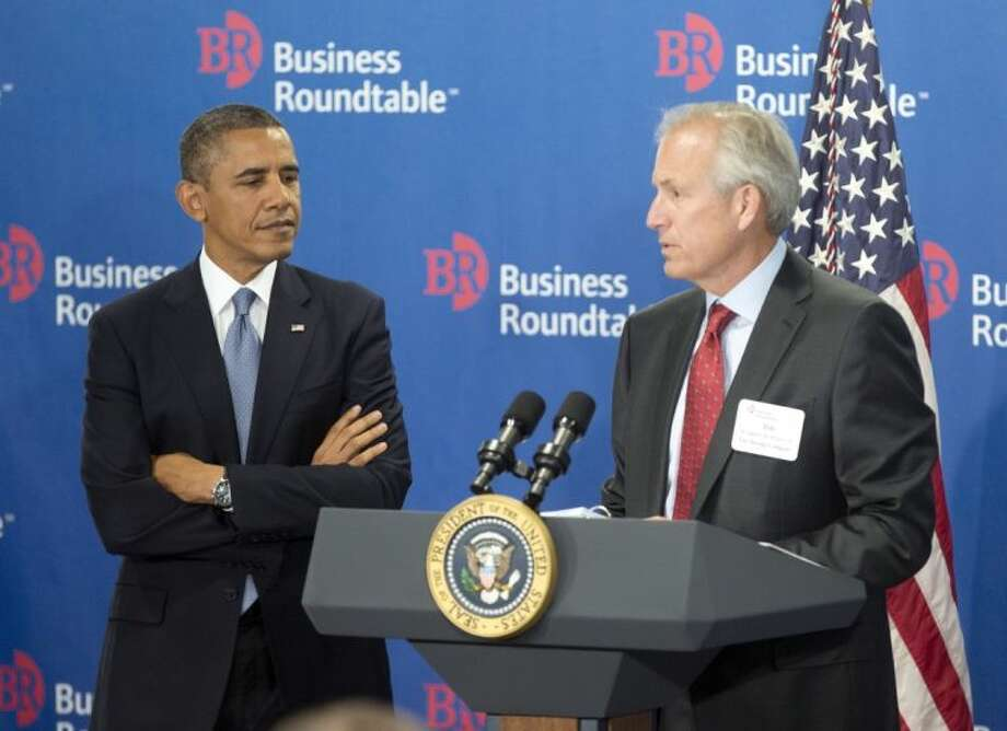 President Barack Obama is introduced by W. James McNerney, Jr., CEO of Boeing, before speaking to members of the Business Roundtable, a trade group representing America's big businesses Wednesday in Washington. Obama, facing a budget showdown with Congress, is pushing his economic agenda to some of the nation's top corporate executives while cautioning Republicans not to precipitate a government shutdown or an unprecedented debt default.