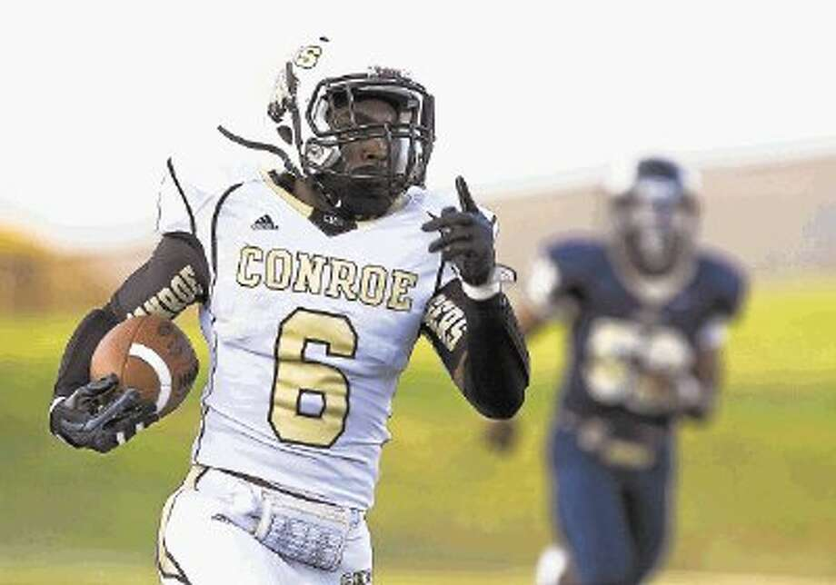 Conroe's Darius Nelms has rushed for 227 yards and four touchdowns this season. Photo: Joe Buvid / © 2013 Joe Buvid